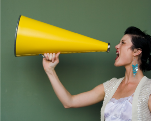 woman-shouting-into-a-megaphone